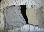 Four t-shirts.  Two short sleeves and two sleeveless.